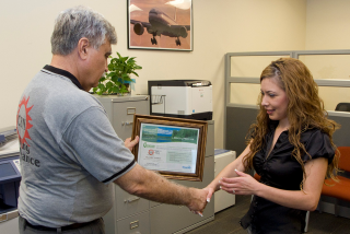 Lots of hand shaking.  This one involves our presenting a client with her Greenguard Environmental Institute facility certification.