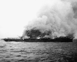1024px-USS_Lexington_(CV-2)_burning_and_sinking_on_8_May_1942_(NH_51382)